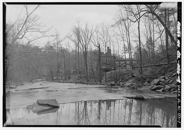 GENERAL VIEW TO FURNACE COMPLEX FROM DAM SITE, LOOKING SOUTHEAST. - Tannehill Furnace, 12632 Confederate Parkway, Tannehill Historical State Park, Bucksville, Tuscaloosa County, AL