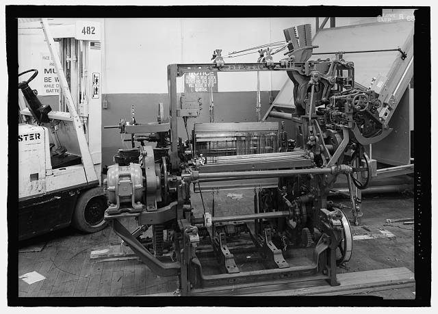 10.  View of Draper darby chain loom from warp beam end, patent date 1913, made by Drpaer Corporation, Hopedale, Massachusetts. Acquired ca. 1941. Note Draper-Northrop name on automatic spindle changer. - Riverdale Cotton Mill, Corner of Middle & Lower Streets, Valley, Chambers County, AL