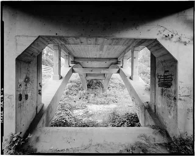 6.  VIEW FROM UNDERNEATH BRIDGE SHOWING CONCRETE DECK SUPPORT, LOOKING SOUTHEAST - Harp Creek Bridge, Spans Harp Creek at State Highway 7, Harrison, Boone County, AR