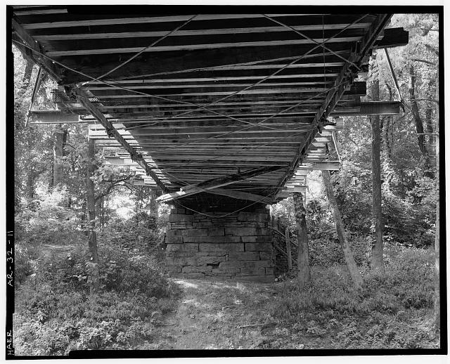 11.  DETAIL VIEW OF UNDERSIDE OF BRIDGE SHOWING DECK SUPPORT SYSTEM, LOOKING SOUTHWEST - Springfield-Des Arc Bridge, Spanning North Branch of Cadron Creek at Old Springfield-Des Arc Road (County Road 222), Springfield, Conway County, AR