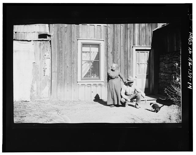 14.  Photocopy of negative (original in possession of WACC), photographer unknown, c.1908 EMMA AND NEIL ERICKSON IN FRONT OF BOARD AND BATTEN SOUTH WALL OF MAIN HOUSE - Faraway Ranch, Willcox, Cochise County, AZ