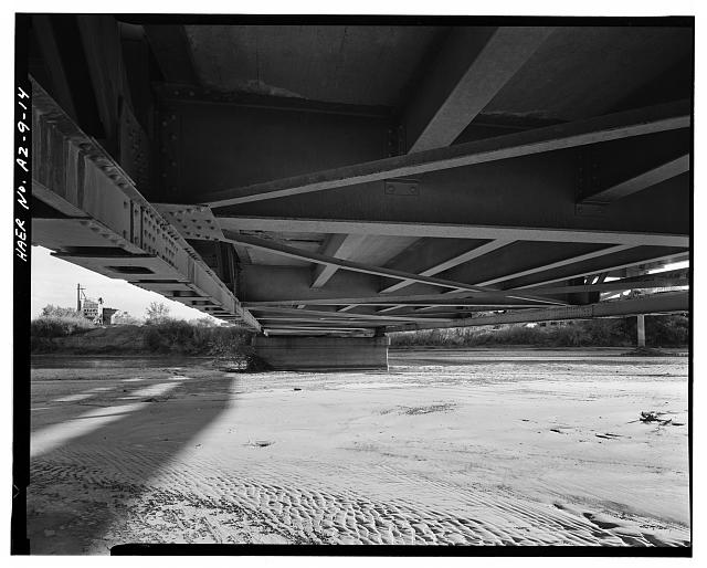 14.  UNDERSIDE OF BRIDGE, SHOWING BOTTOM CHORDS, FLOOR BEAMS, STRINGERS AND BOTTOM LATERAL BRACING. VIEW TO SOUTH. - Holbrook Bridge, Spanning Little Colorado River at AZ 77, Holbrook, Navajo County, AZ
