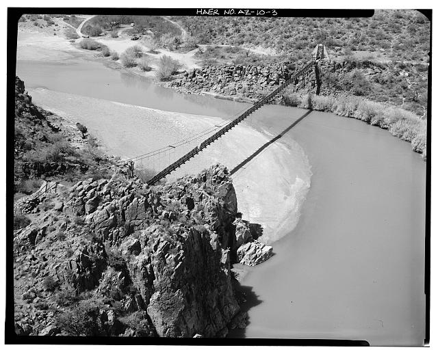 3.  AERIAL VIEW SHOWING THE ENTIRE BRIDGE FROM EAST CABLE ANCHORAGE (EXTREME LEFT) TO WEST CABLE ANCHORAGE (UPPER RIGHT CORNER). March 1987. - Verde River Sheep Bridge, Spanning Verde River (Tonto National Forest), Cave Creek, Maricopa County, AZ