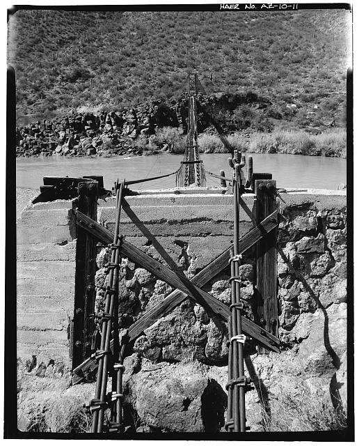 11.  VIEW OF BRIDGE, LOOKING WEST FROM THE EAST MAIN SUSPENSION CABLE ANCHORAGE OVER THE EAST TOWER. THE ORIGINAL WOOD TOWER IS ENCASED IN CONCRETE AND RUBBLE MASONRY. THE VERDE RIVER FLOWS FROM RIGHT TO LEFT. FebruAry 1987 - Verde River Sheep Bridge, Spanning Verde River (Tonto National Forest), Cave Creek, Maricopa County, AZ