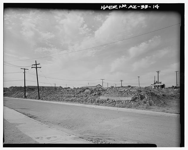 VIEW LOOKING NORTHWEST TOWARD SOUTHEAST CORNER OF SETTLING RESERVOIR NO. 3. THE SOUTHWEST CORNER OF SETTLING RESERVOIR NO. 1 IS AT THE FAR LEFT. THE BLAISDELL SLOW SAND FILTER WASHING MACHINE IS SEEN AT THE RIGHT. THE SOUTHERN PACIFIC RAILROAD RESERVOIR IS SEEN ON THE HORIZON AT LEFT. JONES STREET IS IN THE FOREGROUND. - Yuma Main Street Water Treatment Plant, Jones Street at foot of Main Street, Yuma, Yuma County, AZ