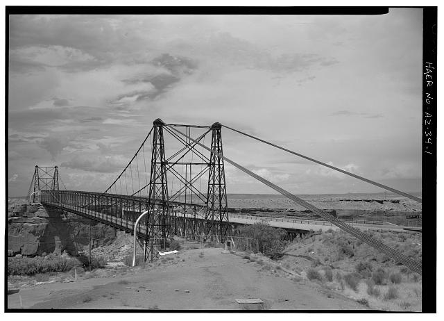 1.  THREE-QUARTER VIEW, FACING NORTH. - Cameron Suspension Bridge, Spanning Little Colorado River on Alternate U.S. Route 89, Cameron, Coconino County, AZ