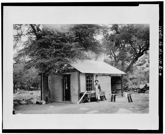 4.  Photocopy of photograph (original in possession of Western Archeological and Conservation Center (WACC), Tucson, Arizona), photographer unknown, undated NEIL ERICKSON WORKING OUTSIDE OFFICE/GARAGE WHEN IT WAS NEW - Faraway Ranch, Office-Garage, Willcox, Cochise County, AZ