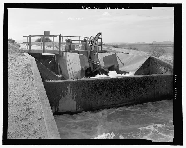 Outlet side of gate, showing the Radial Gate, hoist mechanism and concrete walkway across the canal. The concrete baffle separating the afterbay and the cipoletti weir is in the foreground - Wellton-Mohawk Irrigation System, Radial Gate Check with Drop, Wellton Canal 9.9, West of Avenue 34 East & north of County Ninth Street, Wellton, Yuma County, AZ