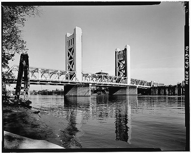 10.  OBLIQUE VIEW OF BRIDGE, LOOKING EAST OF DOWNSTREAM SIDE OF BRIDGE FROM YOLO COUNTY SIDE OF THE SACRAMENTO RIVER - Sacramento River Bridge, Spanning Sacramento River at California State Highway 275, Sacramento, Sacramento County, CA
