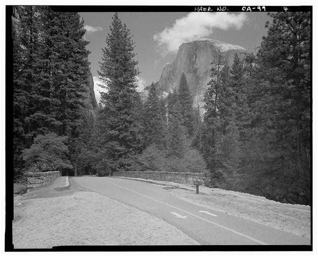4.  FACING EAST ACROSS BRIDGE AT HALF DOME. BICYCLE PATH MARKERS IN FOREGROUND. - Sugar Pine Bridge, Spanning Merced River on service road, Yosemite Village, Mariposa County, CA