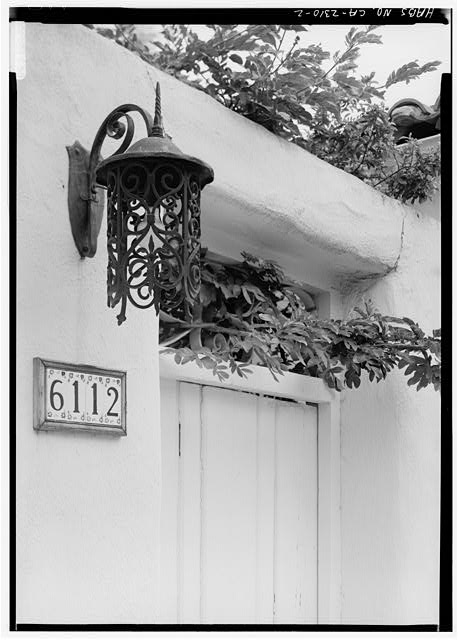 2.  SOUTHEAST FRONT, DETAIL OF LANTERN AND TRANSOM WINDOW OVER DOOR - Spurr-Clotfelter Rowhouse, 6112 Paseo Delicias, Rancho Santa Fe, San Diego County, CA