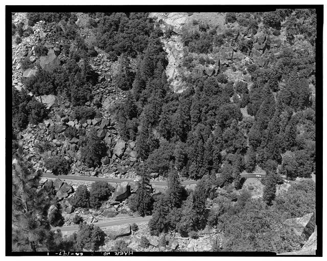 1.  View from middle adit Wawona Tunnel (CA-105) of junction of Highway 120, the Big Oak Flat Road, and Highway 140 showing retaining wall on Hwy.120 at lower left of image. - Big Oak Flat Road, Between Big Oak Flat Entrance & Merced River, Yosemite Village, Mariposa County, CA