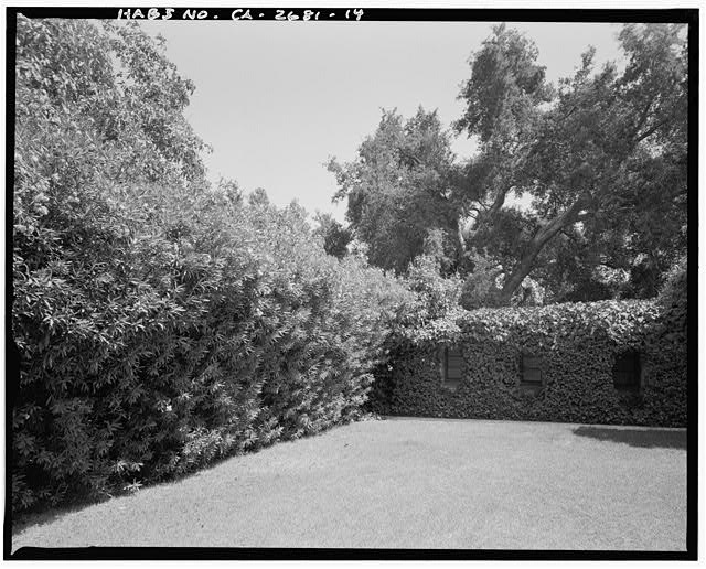 "View of northeast corner of house with abutting oleander on left.  Camera facing 130"" southeast. - Goerlitz House, 9893 Highland Avenue, Rancho Cucamonga, San Bernardino County, CA"