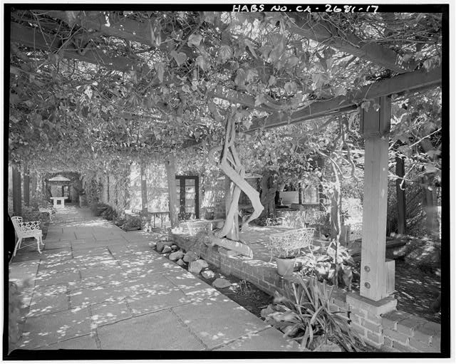 "View of vine-covered arbor on north side of house from current entrance.  Camera facing 104"" east. - Goerlitz House, 9893 Highland Avenue, Rancho Cucamonga, San Bernardino County, CA"
