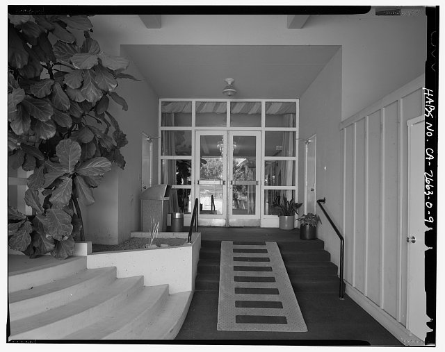 VIEW OF BUILDING 24, DETAIL ON NORTH SIDE, DOORWAY AND STAIRS FROM POOL AREA, FACING SOUTH - Roosevelt Base, Officers' Club, Corner of Pennsylvania Street & Richardson Avenue, Long Beach, Los Angeles County, CA