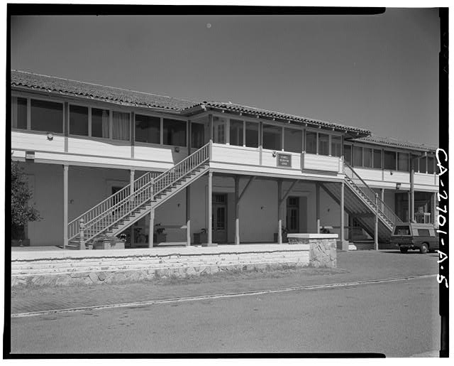 4.  Detail of main center building mass showing porch and exterior stairs to Mezzanine. - Fort Ord, Soldiers' Club, California State Highway 1 near Eighth Street, Seaside, Monterey County, CA