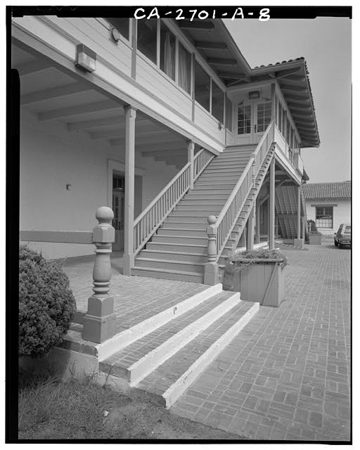 7.  Front porch detail, center front, double door, and timber-bracketed porch support posts. - Fort Ord, Soldiers' Club, California State Highway 1 near Eighth Street, Seaside, Monterey County, CA