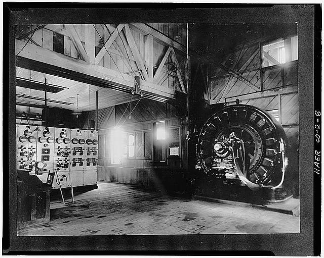 6.  INTERIOR VIEW (c.1900) OF 1895 POWER HOUSE SHOWING SWITCHBOARD ON LEFT AND GENERATOR ON EIGHT. - Ames Hydroelectric Plant, Ames, San Miguel County, CO