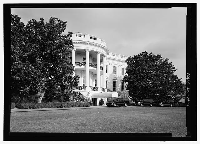 View looking northeast at south facade and porch showing both magnolias - Andrew Jackson Southern Magnolia , 1600 Pennsylvania Avenue, west of south portico, Washington, District of Columbia, DC