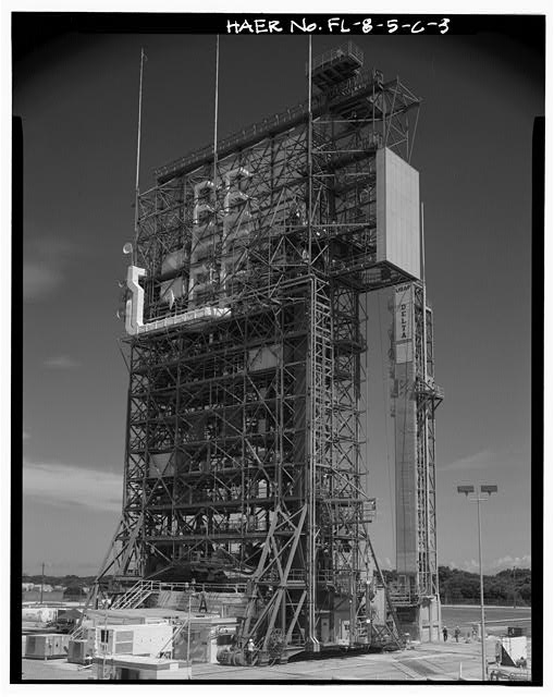 3.  GENERAL VIEW OF WEST AND SOUTH SIDES SHOWING PROJECTING UPPER STAGE ELEVATOR TOP FAR RIGHT; VIEW TO NORTHEAST. - Cape Canaveral Air Station, Launch Complex 17, Facility 28416, East end of Lighthouse Road, Cape Canaveral, Brevard County, FL