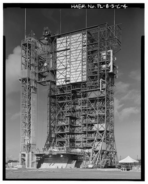 4.  GENERAL VIEW EAST AND NORTH SIDES WITH FIXED UMBILICAL TOWER FAR LEFT; VIEW TO SOUTHWEST. - Cape Canaveral Air Station, Launch Complex 17, Facility 28416, East end of Lighthouse Road, Cape Canaveral, Brevard County, FL
