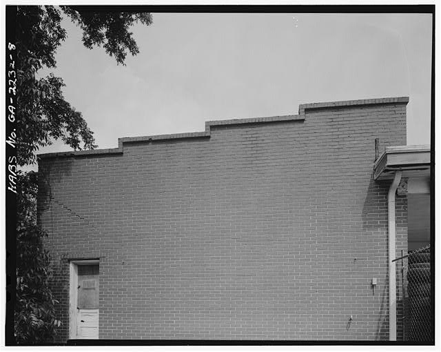 8.  DETAIL OF STEPPED BRICK PARAPET WALL. - Greenhouse Service Station, 522 South Main Street, Woodstock, Cherokee County, GA