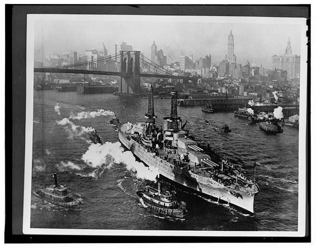 1.  AERIAL VIEW OF USS ARIZONA ON THE EAST RIVER IN NEW YORK CITY NEAR BROOKLYN BRIDGE ON HER WAY TO SEA TRIALS.  NOTE THE BIRD CAGE TOWERS, 1918. - USS Arizona, Submerged off Ford Island, Pearl Harbor, Honolulu, Honolulu County, HI