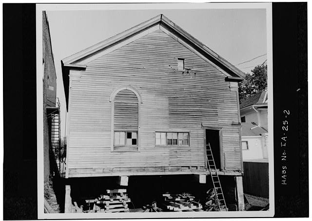 2.  REAR ELEVATION PRIOR TO RELOCATION AND RESTORATION. (The discrepant section of clapboarding shows where a tower was added in a mid-1880s alteration.) - Quaker Meetinghouse, Downey Street, Wapsinono Creek Vicinity, West Branch, Cedar County, IA