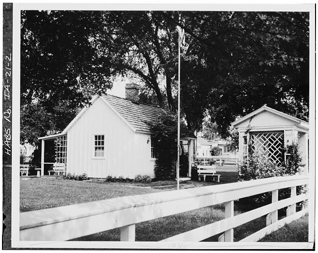 2.  EAST FRONT AND SOUTH SIDE (TO RIGHT IS GATEWAY BUILDING BUILT 1952) - Herbert Hoover Birthplace House, Southwest corner of Penn & Downey Streets (moved), West Branch, Cedar County, IA