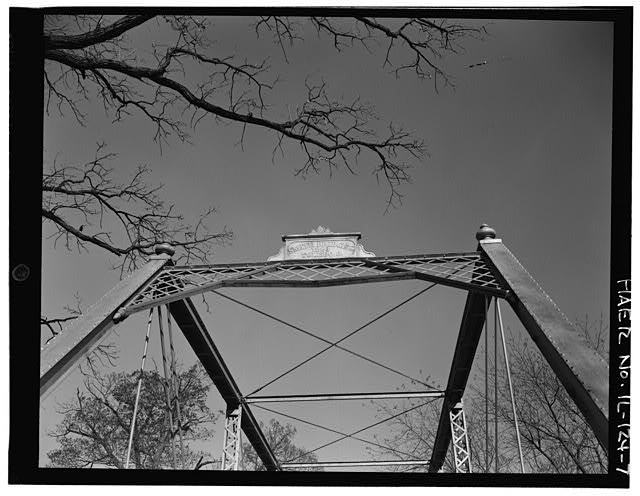 7.  WEST PORTAL, UPPER AREA, SHOWING BRACINGS AND PLAQUE - Butzow Bridge, Crescent City, Iroquois County, IL