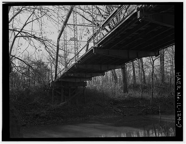 9.  FLOOR BEAMS AND STRINGERS, VIEW TO NORTHWEST FROM CREEK BED - Butzow Bridge, Crescent City, Iroquois County, IL