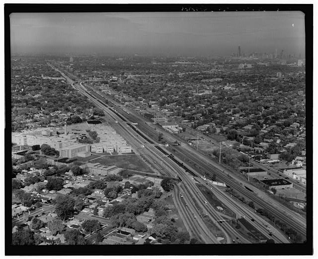 12.  AERIAL VIEW, LOOKING NNW, SHOWING NORTH END OF CHICAGO SKYWAY CORRIDOR. TOLL PLAZA TOWARD BOTTOM OF FRAME. - Chicago Skyway Toll Bridge, I-90, for 7.8 miles from South State Street to Indiana state line, Chicago, Cook County, IL