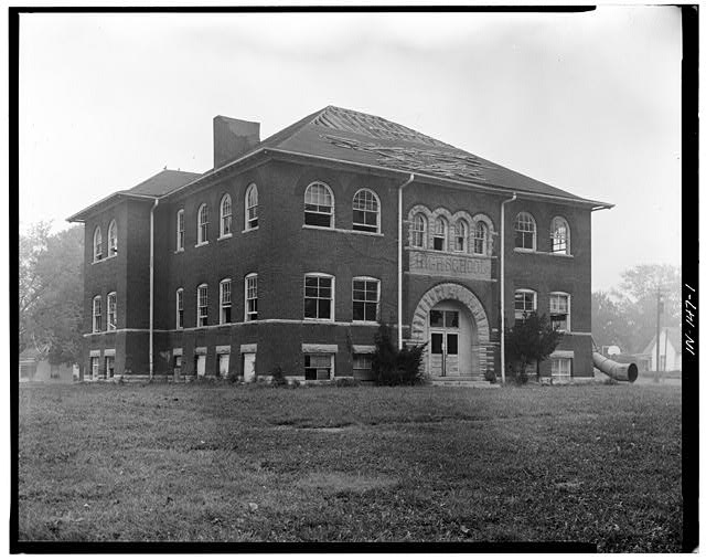 1.  THREE QUARTER VIEW OF NORTH (SIDE) AND WEST (FRONT) ELEVATION - Riley School, Seventh & College Streets, Mitchell, Lawrence County, IN