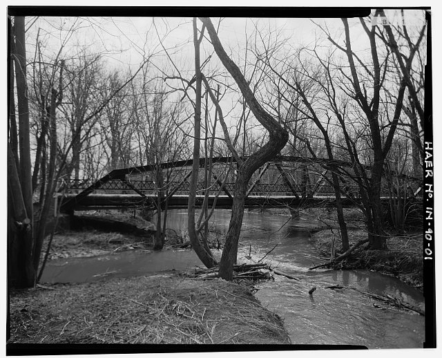 1.  VIEW LOOKING SOUTH OF THE NORTH SIDE OF THE BRIDGE, SHOWING THE SILLOUETTE OF THE POLYGONAL TOP CHORD AND THE THICKNESS OF THE DECKING. - Madison County Bridge 90, Spanning Killbuck Creek on County Road No. 600, Moonville, Madison County, IN