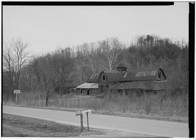 8.  OXEN BARN FROM THE ROAD. - Hunnewell Iron Furnace, Junction of State Routes 2 & 1773, Hunnewell, Greenup County, KY