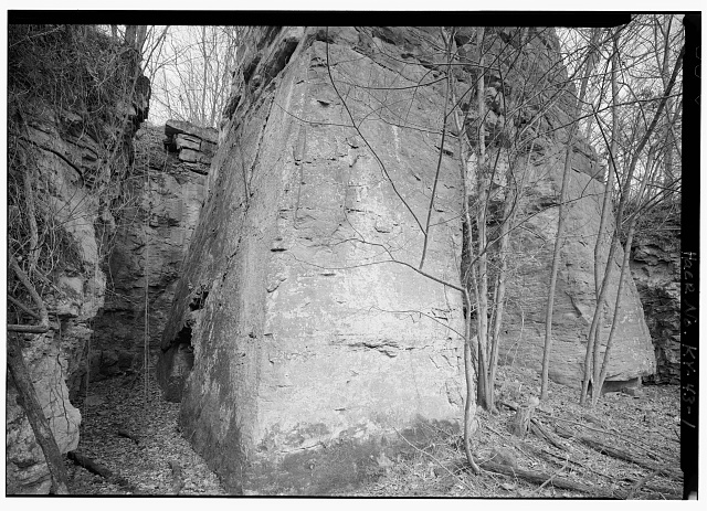 1.  BASE OF LAUREL IRON FURNACE LOOKING NE. NOTE HOW BASE IS CARVED OUT OF ONE PIECE OF LIMESTONE. - Laurel Furnace, KY 1 & Laurel Creek Road, Oldtown, Greenup County, KY