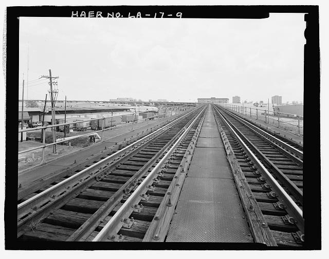 VIEW OF EAST BANK RAILROAD APPROACH TO BRIDGE LOOKING WEST. - Huey P. Long Bridge, Spanning Mississippi River approximately midway between nine & twelve mile points upstream from & west of New Orleans, Jefferson, Jefferson Parish, LA