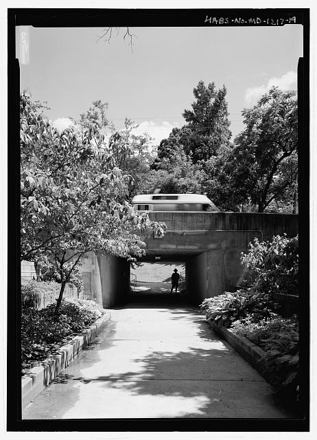PEDESTRIAN UNDERPASS AT CRESCENT ROAD AND ROOSEVELT CENTER FROM NORTH.  NOTE DALE WINLING, 2005 SALLY KRESS TOMPKINS FELLOW, WALKING THROUGH UNDERPASS. - Old Greenbelt, Crescent Road and Southway, Greenbelt, Prince George's County, MD