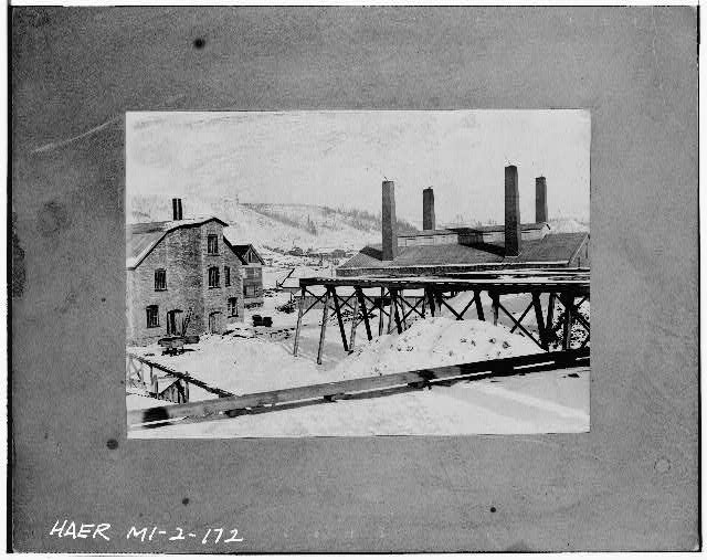 172.  Photocopied July 1978, (LGK) VIEW SHOWING CUPOLA BUILDING (LEFT) AND REVERBERATORY FURNACE BUILDING (RIGHT) AT QUINCY SMELTER. C. 1898. - Quincy Mining Company, Hancock, Houghton County, MI