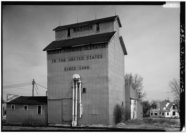 2.  PERSPECTIVE VIEW OF WEST (FRONT) LOOKING NORTHEAST - Watson Farmer's Elevator, U.S. Highway 59, Watson, Chippewa County, MN