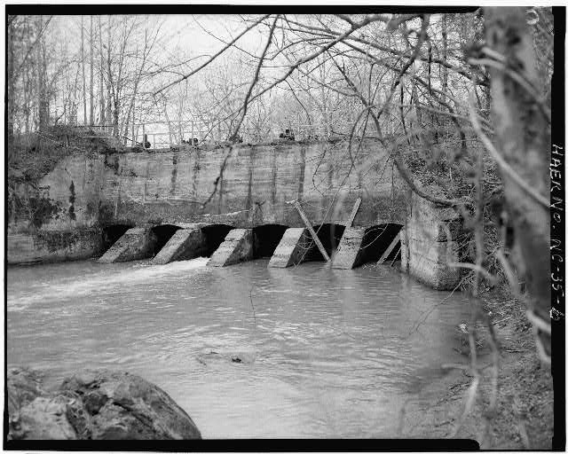 6.  VIEW, LOOKING WEST, AT SLUICE GATES AT DAM FROM NORTH BANK OF DEEP RIVER - Lockville Hydroelectric Plant, Deep River, 3.5 miles upstream from Haw River, Moncure, Chatham County, NC