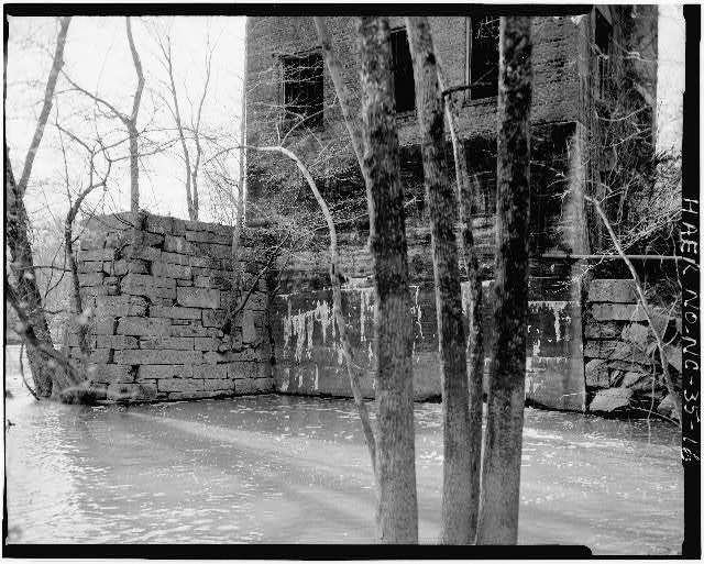 16.  VIEW SHOWING EAST ELEVATION OF POWERHOUSE AND MASONRY RETAINING WALLS - Lockville Hydroelectric Plant, Deep River, 3.5 miles upstream from Haw River, Moncure, Chatham County, NC