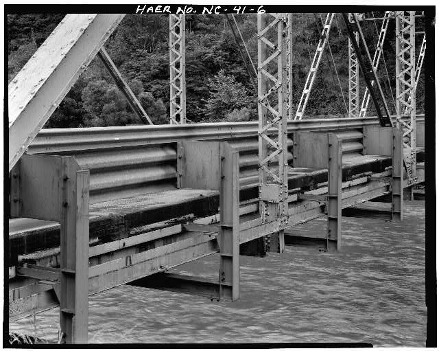 6.  VIEW OF BRIDGE FOOTING AND RAILING, FROM NORTHWEST - North Carolina Route 1314 Bridge, Spanning Toe River, Relief, Mitchell County, NC