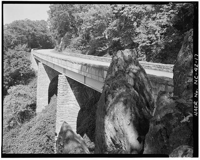 17.  Rocky Mountain viaduct. This steel girder viaduct was built in 1942. All of the reinforced concrete was faced with a rustic stone facade. View is to east. - Blue Ridge Parkway, Between Shenandoah National Park & Great Smoky Mountains, Asheville, Buncombe County, NC
