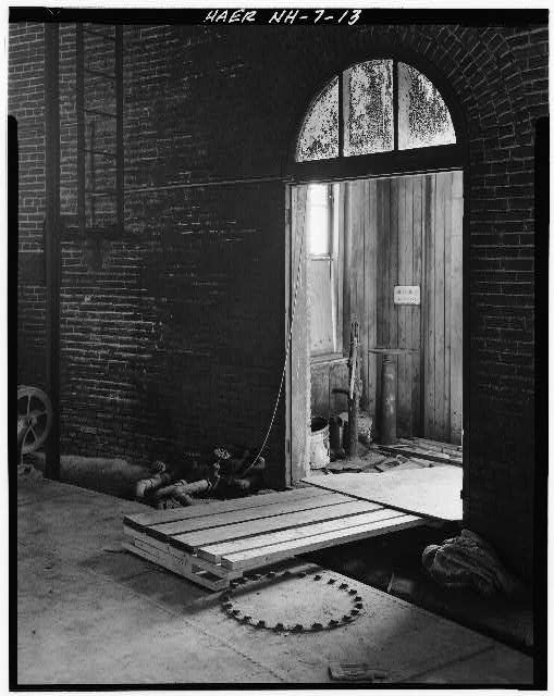 13.  Interior view looking from inside Gasholder House through doorway to valve house. - Concord Gas Light Company, Gasholder House, South Main Street, Concord, Merrimack County, NH