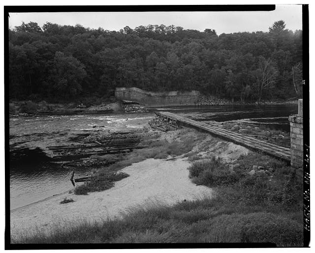 1.  View southeast, coffedam to the left, east end of spillway and east abutment to the rear. West end of spillway and west abutment to the right - Sewall's Falls Hydroelectric Facility, East end of Second Street spanning Merrimack River, Concord, Merrimack County, NH