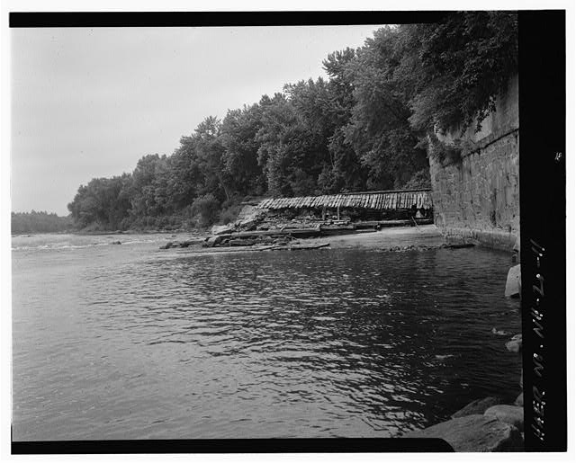 11.  View north and upstream, east end of spillway, east abutment - Sewall's Falls Hydroelectric Facility, East end of Second Street spanning Merrimack River, Concord, Merrimack County, NH
