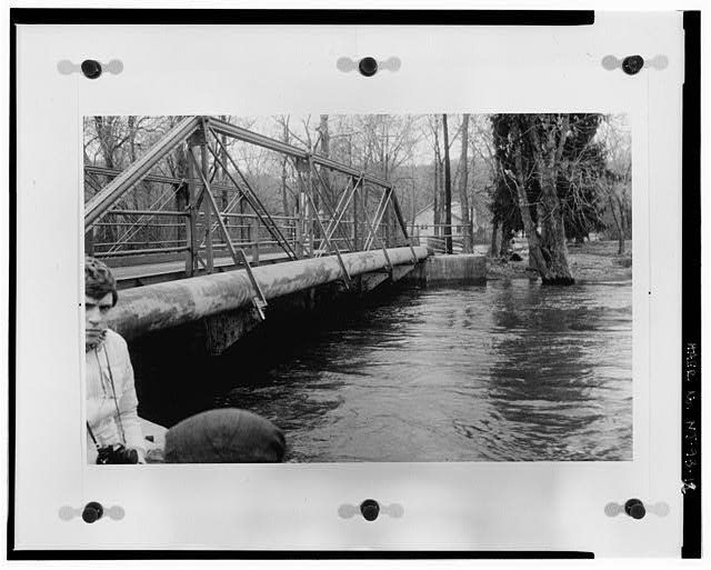 12.  EAST SIDE OF DOTY ROAD BRIDGE DURING A FLOOD, CA. 1980, LOOKING SOUTHEAST. PHOTOGRAPHER AND SUBJECT ARE NOT KNOWN. ORIGINAL PHOTOGRAPH IS LOCATED IN THE NEW JERSEY HISTORIC PRESERVATION OFFICE, TRENTON, NJ. REPRINTED WITH PERMISSION AND MAY BE REPRODUCED. - Doty Road Bridge, Doty Road, spanning Ramapo River, Oakland, Bergen County, NJ