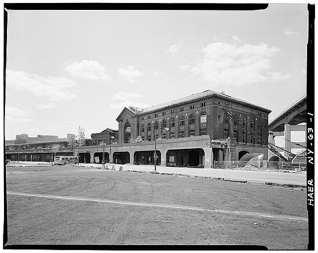 1.  View of DL&W Terminal complex from Main Street looking southeast. Train shed is at far left in photo with two passenger buildings flanking it the larger abutting the elevated skyway at extreme right. Naval Park is under construction directly beneath Skyway. - Delaware, Lackawanna & Western Railroad, Lackawanna Terminal, Main Street & Buffalo River, Buffalo, Erie County, NY