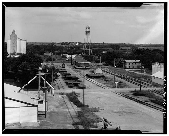 1.  EXTERIOR, AERIAL VIEW, LOOKING EAST - St. Louis, San Francisco Railroad Station, Perry, Noble County, OK